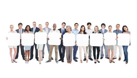 network people: Multi-Ethnic Group Of Business And Casual People Holding 9 Letters Empty Cardboards. Stock Photo