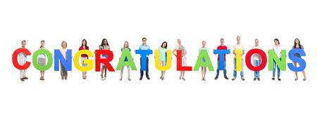 「おめでとう」の文字を保持しているビジネス人々 のグループ