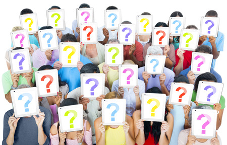 Multi-ethnic group of people holding the talets question mask screen photo