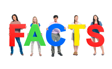 Group of Business people holding the letter FACTS