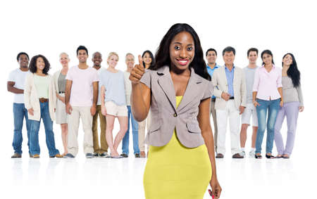 standing out from the crowd: Young adult woman standing out from crowd