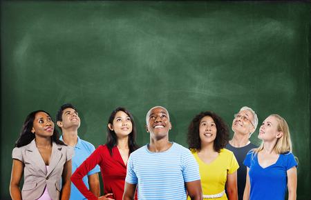 Group of Multiethnic Students Looking Up with Blackboard Banco de Imagens
