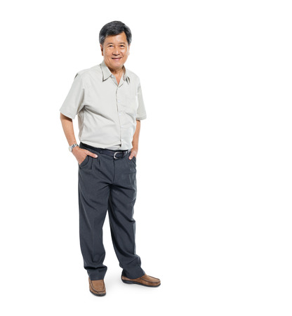 Confident Mature Man Standing and Smiling Stock Photo