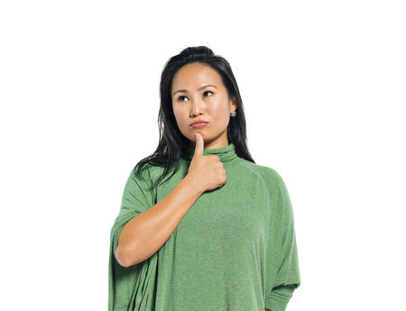 A Young Casual Asian Woman Thinking photo