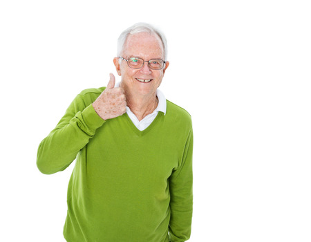 thumbs up man: A Cheerful Casual Old Man Giving a Thumbs Up Stock Photo