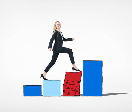adversity: Businesswoman Conquering Adversity Concept Stock Photo