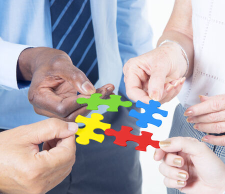 teamwork hands: Group business people connecting jigsaw together Stock Photo