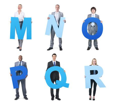 Gruppe der Geschäftsleute, die das Alphabet Standard-Bild - 31298652