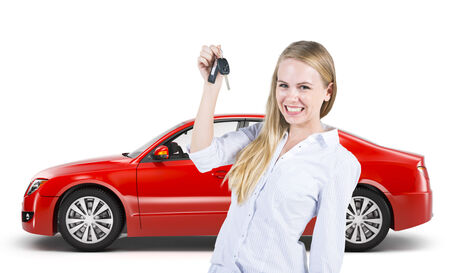 new car: Woman holding the cars key with the red sodan cars background