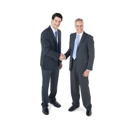 business people standing: Two Cheerful Corporate men having a Business Agreement