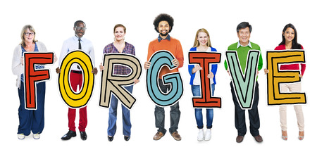 Group of People Standing Holding Forgive Letter photo