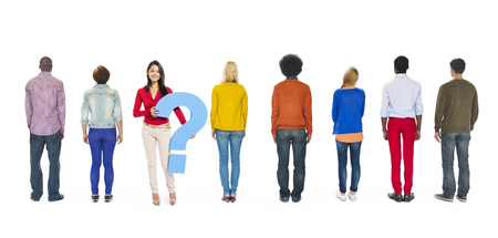 People Facing Backwards with Woman Holding Question Mark photo