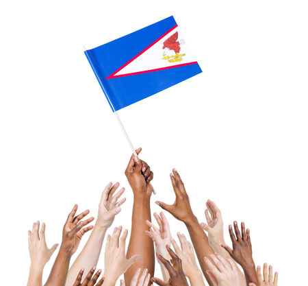 winning location: Human hand holding American Samoa flag among multi-ethnic group of peoples hand