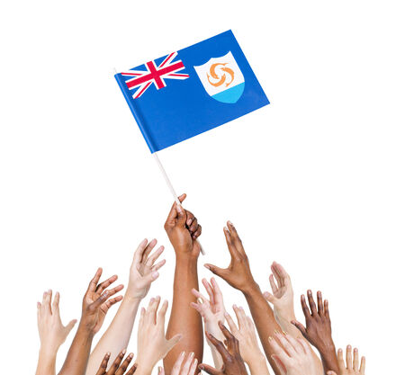 winning location: Human hand holding Anguilla flag among multi-ethnic group of peoples hand