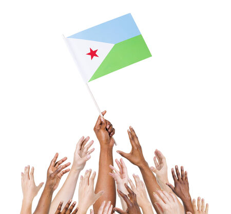 Group of multi-ethnic people reaching for and holding the flag of Djibouti. photo