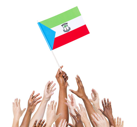 raise the white flag: Group Of Multi-Ethnic People Reaching For And Holding The Flag Of Equatorial Guinea Stock Photo