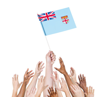 raise the white flag: Group of multi-ethnic people reaching for and holding the flag of Fiji.