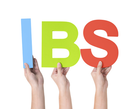 ibs: Group of Multiethnic Hands Holding IBS
