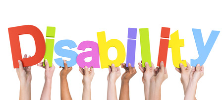 Group of Multiethnic Hands Holding Disability Stock Photo
