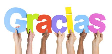 Multiethnic Group of Hands Holding Gracias photo