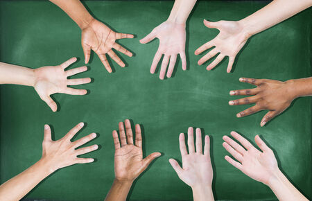 Group of Diverse Multiethnic Hands on a Blackboard photo