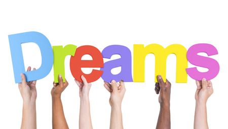 Multiethnic Group of Hands Holding Dreams photo