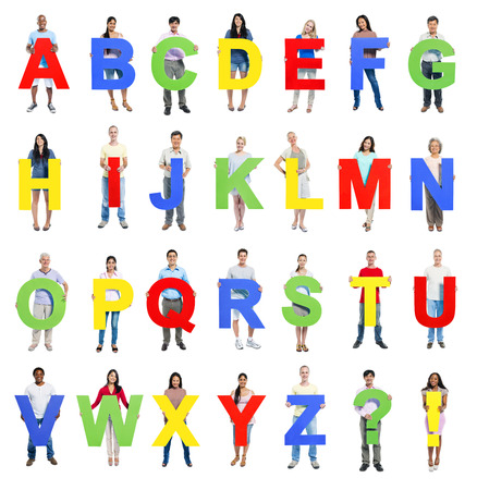 exclamation mark: Multi-ethnic group of people holding the Letter A-Z Stock Photo