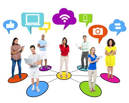 global village: Multi-ethinic people social networking via modern technology. Stock Photo