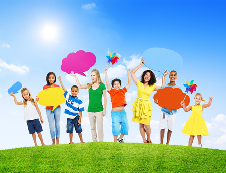 mixed age: Group of Mixed Age Holding Colorful Speech Bubbles in a Summer Concept Photo