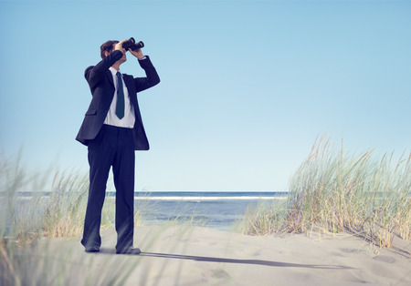 executive search: Business Man Holding Spyglass on Beach