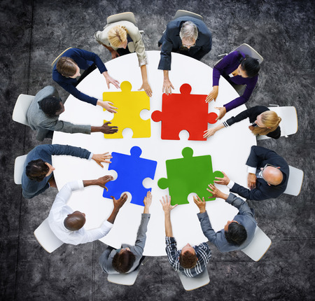 red puzzle piece: Business People with Jigsaw Pieces for Connection Concept