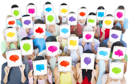 Multi-ethnic casual people holding the tablets speech bubble screen