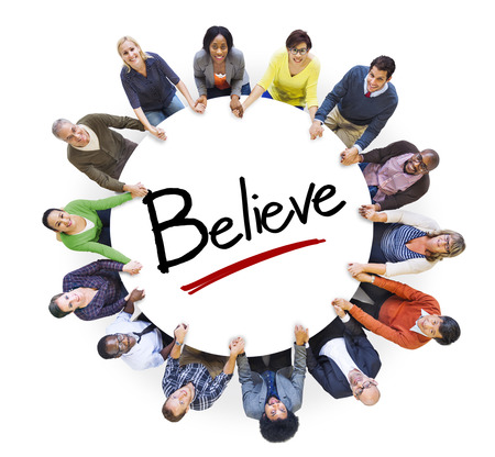 Multi-Ethnic Group of People Holding Hands and Belief Concept Stock Photo
