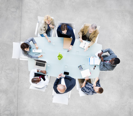 work: Group Of  Business People Around The Conference Table Having A Meeting Stock Photo