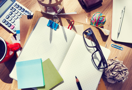Messy Designer's Table with Blank Note and Tools