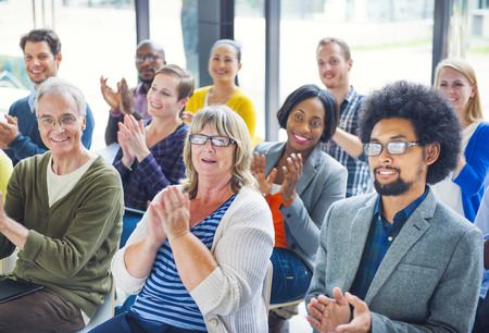 Group of Cheerful People Clapping with Gladness Stock Photo