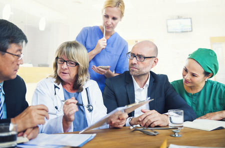 healthcare worker: Healthcare Workers Having a Meeting Stock Photo