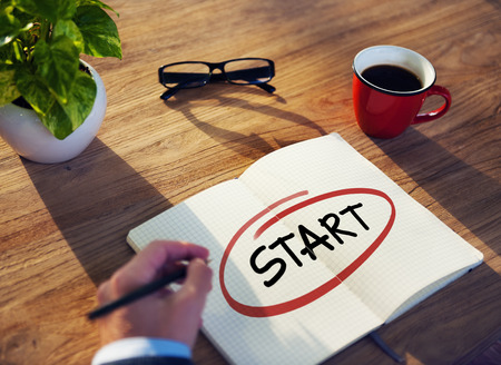 activate: Businessman Writing the Word Start Stock Photo