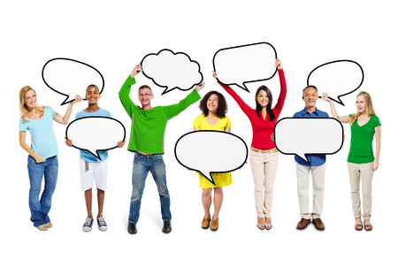 Group of multi-ethnic people standing with speech bubbles in their hands. photo