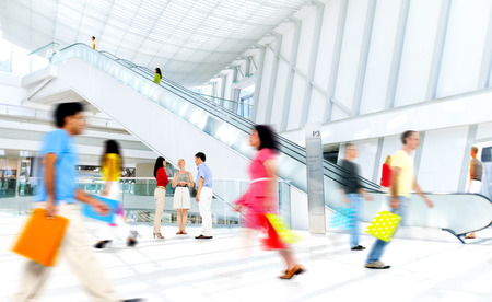 shopping scenes: Motion Blurred People in the Shopping Mall Stock Photo
