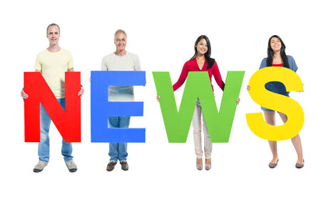 Multi-ethnic group of people holding NEWS letters photo