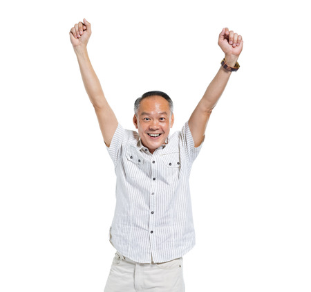 Cheerful Old Asian Man Celebrating Stock Photo