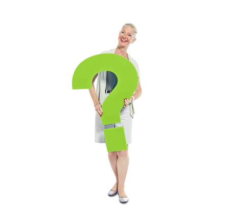 A Casual Woman Holding a Green Question Mark photo