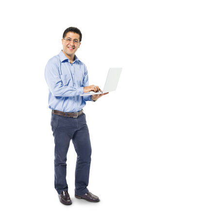 A Smart Casual Mans Standing while using his Laptop photo