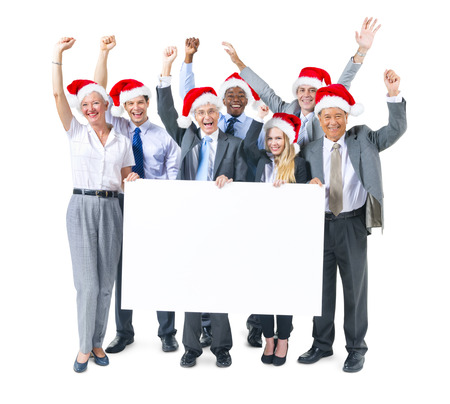 Group of Business People Celebrating and Holding Placard photo
