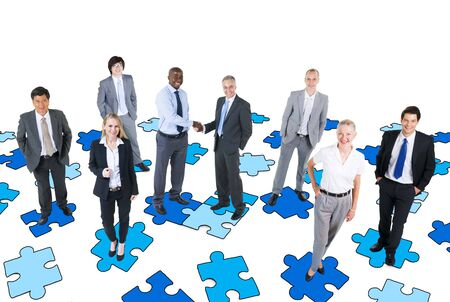 Group of Business People with Jigsaw Puzzle photo