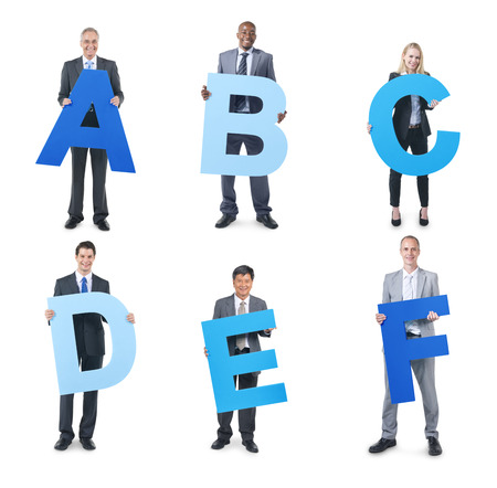 Group of Business People Holding the Alphabet photo