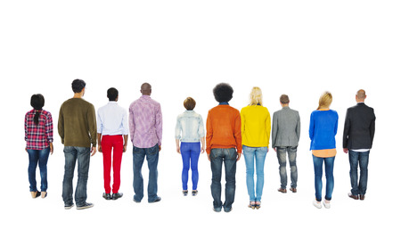 in behind: Group of Multiethnic Colorful People Facing Backwards Stock Photo