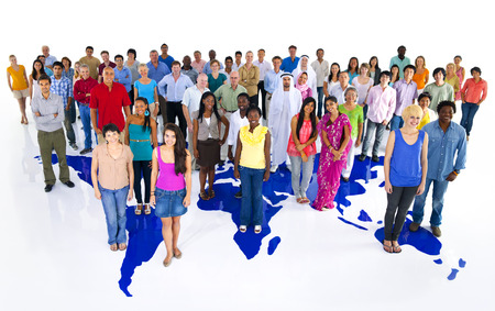 large multi-ethnic group of world people isolated on white background with world map.