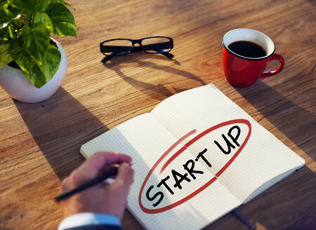 Man with Note Pad and Startup Business Concepts photo